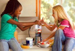 getty_rm_photo_of_two_girls_blending_fruit_smoothie